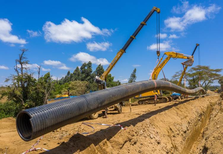 A 60m long section of Weholite HDPE Structured Wall Pipes is lowered into the trench at Narok